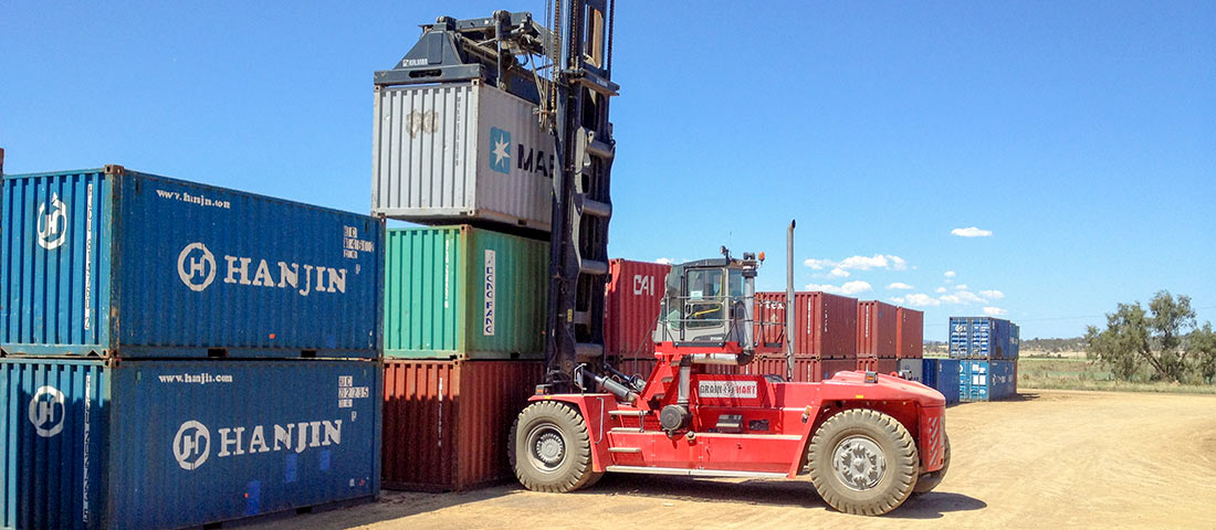 Stacking shipping containers at the Grainhart site